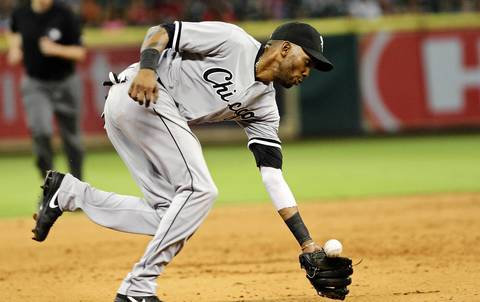 Alexei Ramirez attempts to field a ground ball during the fifth inning against the Astros.