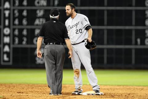 Pinch-runner Jordan Danks argues with an umpire after being picked off to end the game.