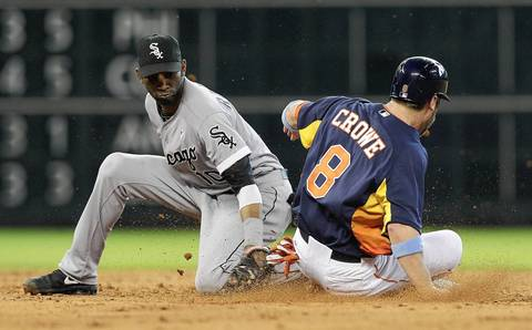 The Astros' Trevor Crowe takes second base on a wild pitch in the sixth inning as Alexei Ramirez is late on the tag.