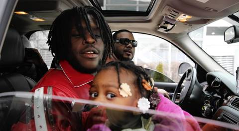 Chief Keef, 17, holds his daughter before leaving the Cook County Juvenile Temporary Detention Center. He had been on an 18-month probation after his conviction for pointing a gun at a Chicago police officer in 2011.