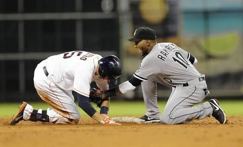 Jason Castro of the Astros slides in ahead of the tag by Alexei Ramirez of the Sox after hitting a double in the third inning.