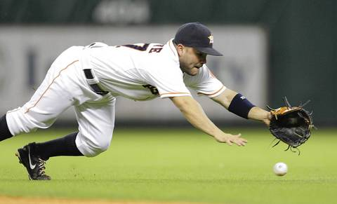 Jose Altuveof the Houston Astros makes a diving attempt on ball hit by Conor Gillaspie.