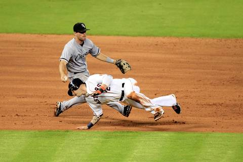 n Astros center fielder Brandon Barnes dives under the tag attempt by White Sox third baseman Conor Gillaspie during a rundown in the fifth.