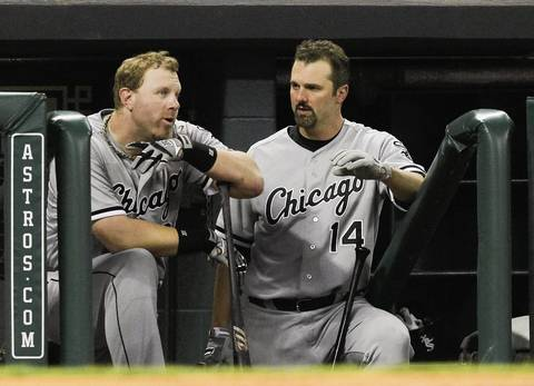 Adam Dunn and Paul Konerko talk in the dugout.