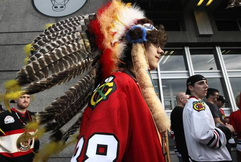 Blackhawks fan William Kane, of Chicago, makes his way to Game 5 of the Hawks-Kings Western Conference Finals at the United Center.