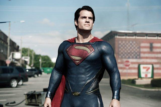 Don't be fooled by the suit. Cavill finds a reason or two to take it off.