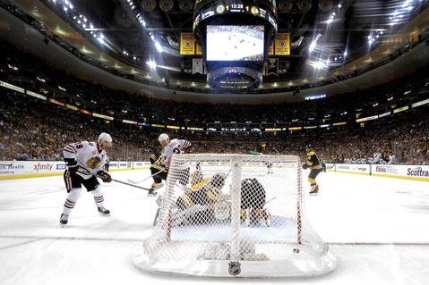 Jonathan Toews scores a goal past Bruins goalie Tuukka Rask in the second period of Game 4.