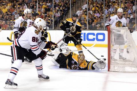 Patrick Kane scores a goal past Bruins goalie Tuukka Rask during the second period of Game 4.
