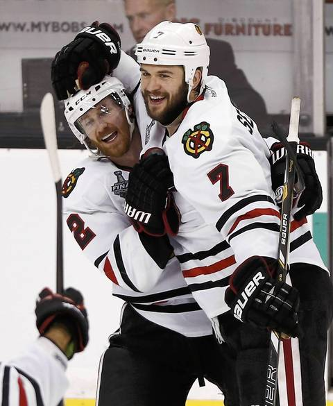 Brent Seabrook celebrates his game-winning overtime goal in Game 4 with Duncan Keith.