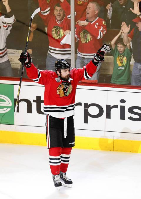 Patrick Sharp celebrates after scoring a goal against the Bruins during the first period of Game 2.