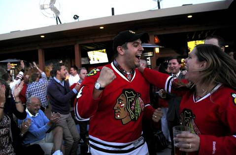 Alex Lange and wife Linnea Sandstrom Lange celebrate after the Chicago Blackhawks scored on the Boston Bruins during game 4 of the Stanley Cup Finals. The couple was watching the game with other Swedish Blackhawks fans at Market Bar in Chicago's West Loop.