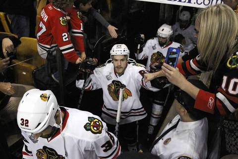 Andrew Shaw high-fives fans as the Hawks take the ice.