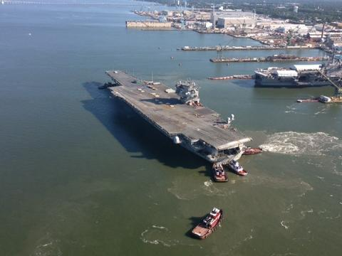 An aerial view of the USS Enterprise's arrival at Newport News Shipbuilding for the final time.