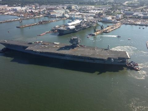 Aerial views of the USS Enterprise making its way to the Newport News Shipyard for the last time.