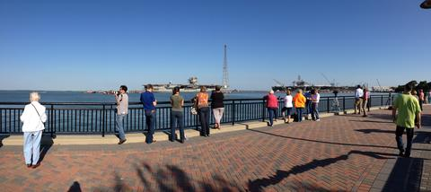 A panoramic view of the waterfront as people gather to welcome the USS Enterprise to Newport News Shipbuilding for the last time.