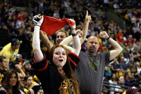 Blackhawks fans celebrate a goal by Marcus Kruger in the second period.