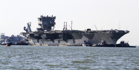 The USS Enterprise is turned to dock at the Newport News shipyard after being towed from Naval Station Norfolk.