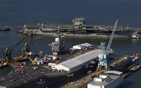 The USS Enterprise is towed to the Newport News Shipyard on Thursday morning.