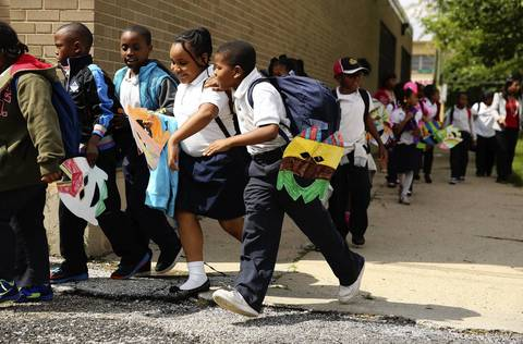 Students leave Marcus Garvey Elementary School in Chicago after it was announced their school would not be closed by CPS.