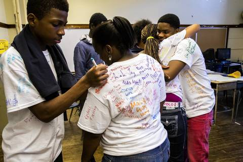 Seventh grade students hug and sign shirts just before dismissal on the last day of school at West Pullman Elementary. The CPS is closing this school and relocating the students to existing schools in the neighborhood.