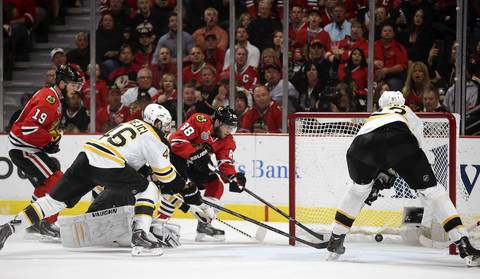 Patrick Kane scores past Bruins goalie Tuukka Rask in the first period.