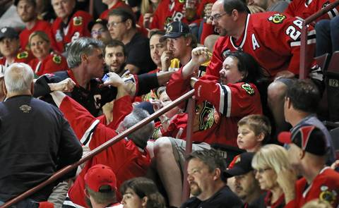 Two Blackhawks fans get into a fight in the first period of Game 5 of the Stanley Cup Final at the United Center.