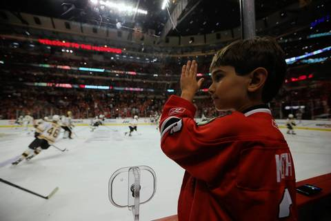 Blackhawks fan Charlie Hahn, 7, checks out the warmups before Game 5 of the Stanley Cup Final at the United Center.