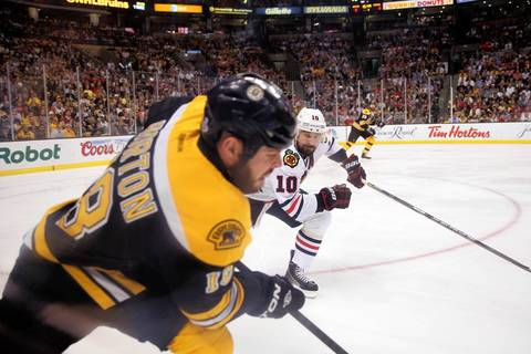 Patrick Sharp pursues the Bruins' Nathan Horton in the first period.