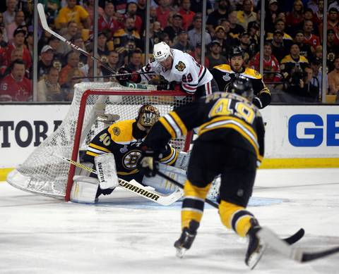 Bryan Bickell dislodges the Bruins' goal.