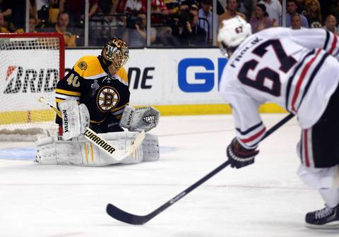 Bruins goalie Tuukka Rask makes a save after a shot by Michael Frolik in the first period.
