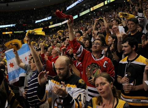 Blackhawks and Bruins fans cheer during the National Anthem.