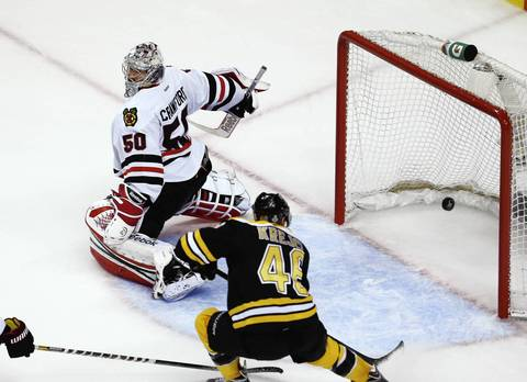 The Bruins' David Krejci misses an easy shot in front of the net of Corey Crawford during the first period.