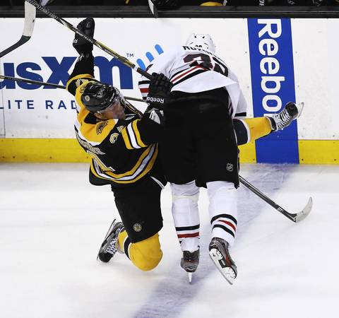 Michal Rozsival puts a hit on the Bruins' Carl Soderberg during the first period.