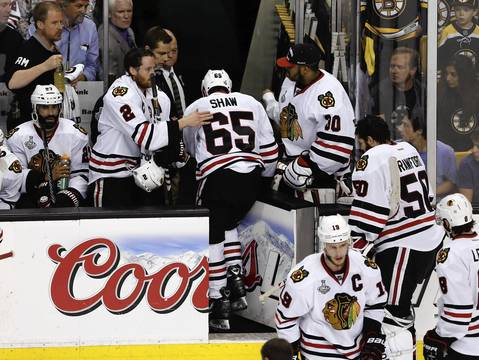 Duncan Keith pats Andrew Shaw as he leaves with an injury during the first period.