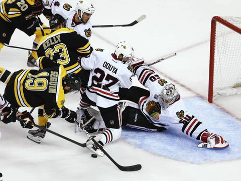 Goalie Corey Crawford stretches to defend against the Bruins' Tyler Seguin during the first period.