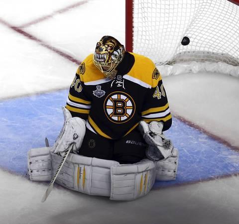 The puck gets past Bruins goalie Tuukka Rask for a goal by Jonathan Toews.
