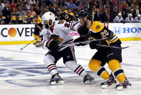 Johnny Oduya fights off the Bruins' Daniel Paille in the second period.