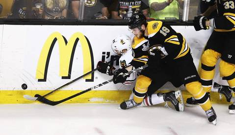 Viktor Stalberg battles along the boards with the Bruins' Tyler Seguin during the second period.