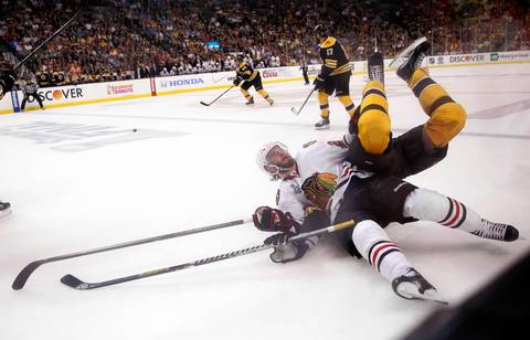 The Bruins' Zdeno Chara flips over Brandon Saad in the second period.