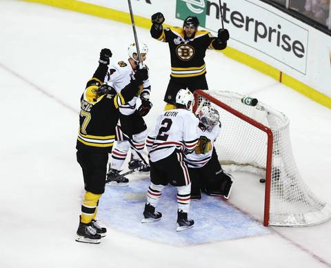 The Bruins' Milan Lucic celebrates after scoring a goal in the third period to give Boston a 2-1 lead.