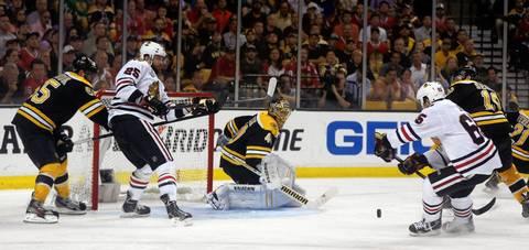 Andrew Shaw is challenged by the Bruins' Tyler Seguin as he heads toward goalie Tuukka Rask.