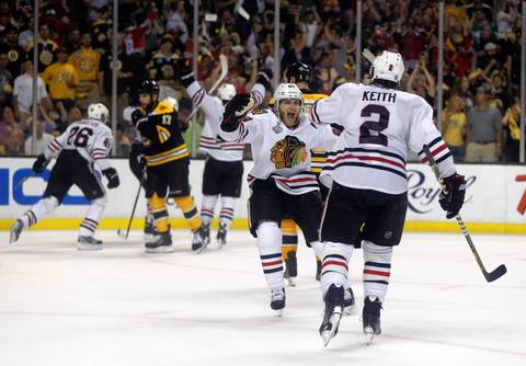 Patrick Kane celebrates a Dave Bolland goal with Duncan Keith in the third period.