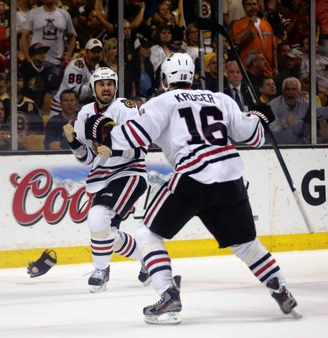 Dave Bolland celebrates his goal with Marcus Kruger that gave the Hawks a 3-2 lead.