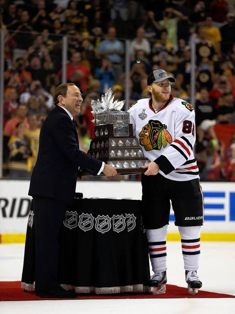 Patrick Kane is presented the Conn Smythe Trophy from NHL Commissioner Gary Bettman.