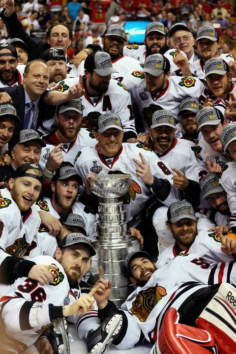 The Blackhawks celebrate with the Stanley Cup.