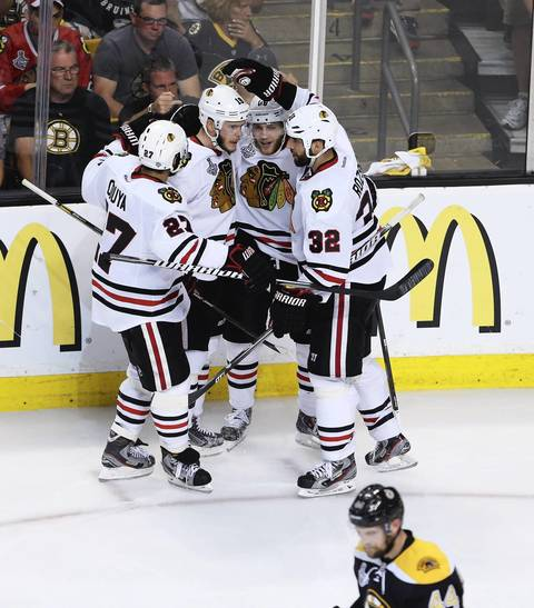 Jonathan Toews is congratulated by his teammates after scoring a second period goal against the Red Wings in Game 5.
