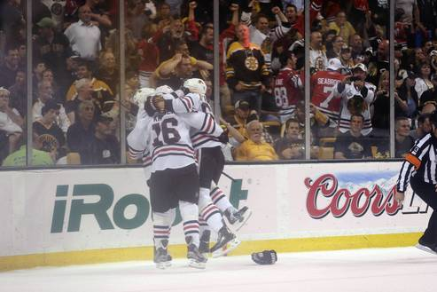 Fans cheer as Dave Bolland celebrates with teammates after his third period goal in Game 1.