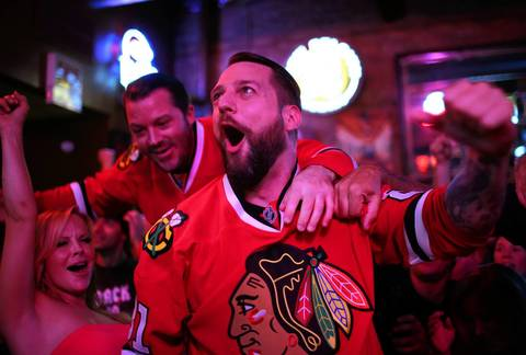 Fans celebrate the Blackhawks Stanley Cup victory at the Third Rail Tavern on Madison Street, in Chicago.