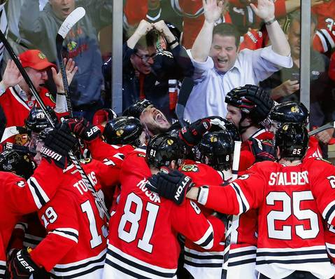 Seabrook lets out a scream while being mobbed by teammates after scoring an overtime goal to defeat the Red Wings and win Game 7.