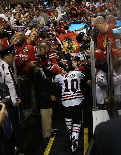 Chicago Blackhawks' Patrick Sharp heads to the dressing room after the Blackhawks won the Stanley Cup over the Boston Bruins in Game 6 of the NHL Stanley Cup Final at the TD Garden in Boston.